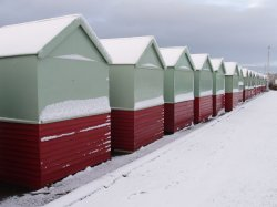 Row of beach huts covered with snow